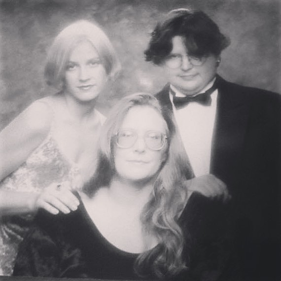 photo of a black and white Glamour Shots photo with my mom and brother from 1994